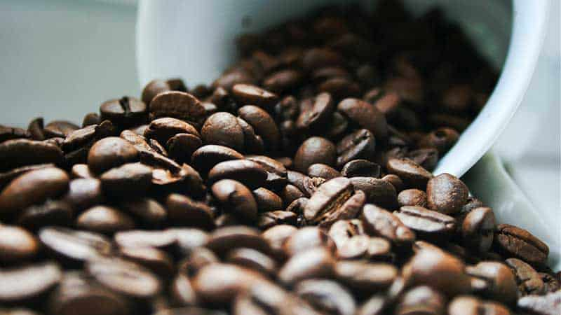 buy unroasted coffee beans - cup of beans