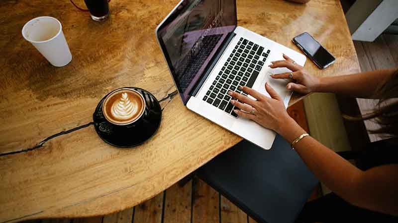 typing and coffee cup